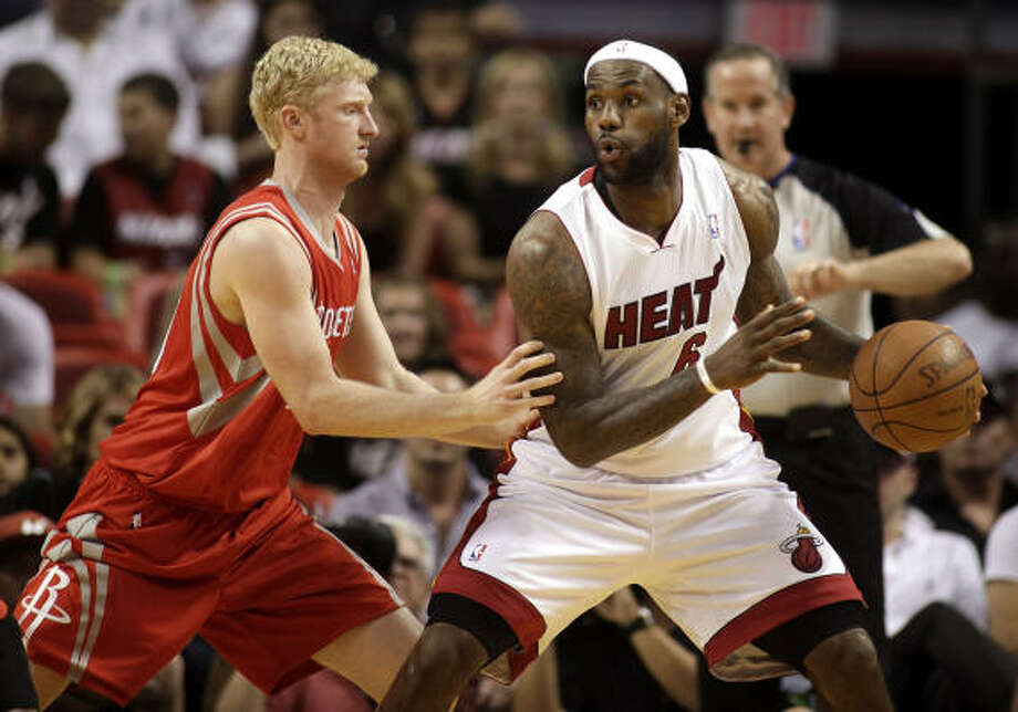 Heat forward LeBron James goes for a play against Rockets forward Chase Budinger. Photo: Marc Serota, Getty Images