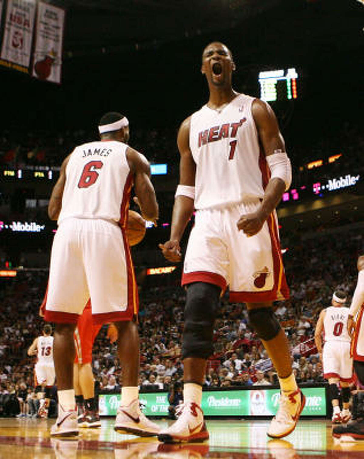 Heat Forward Chris Bosh reacts after a play.