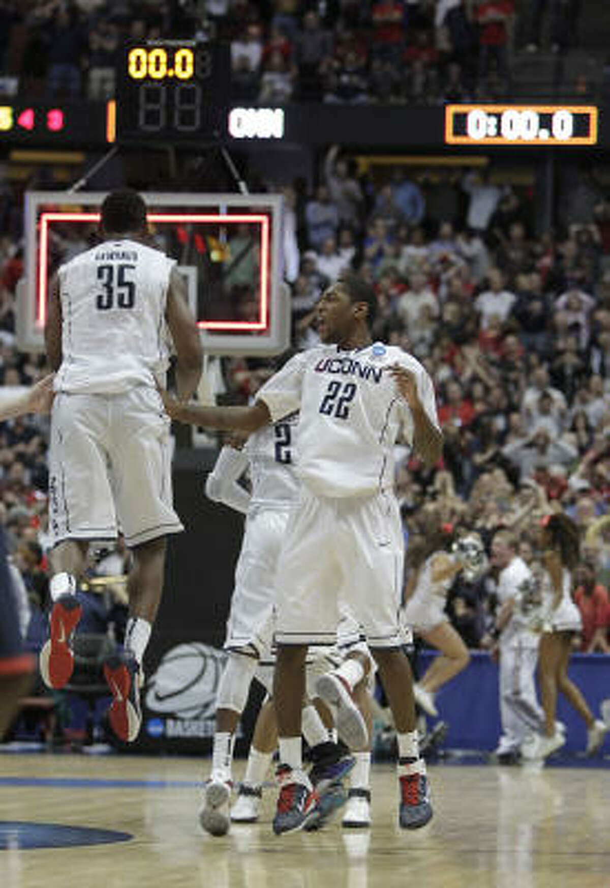 West Regional final: UConn 65, Arizona 63 Connecticut Huskies team celebrates together on the court after defeating the Arizona Wildcats 65-63 in the NCAA West Regional Final. UConn advances to the Final Four in Houston.
