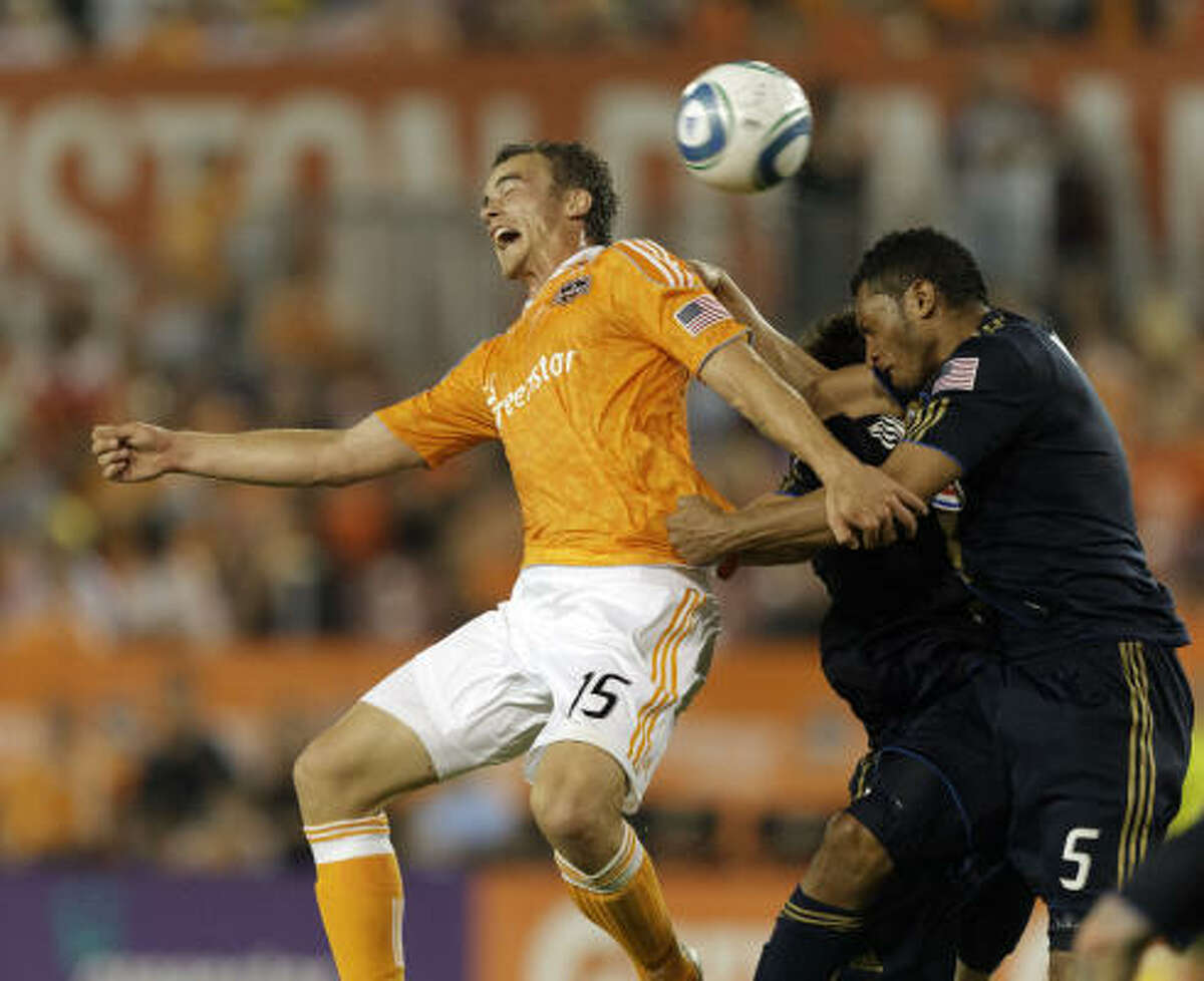 Dynamo's Geoff Cameron heads the ball on goal as Carlos valdes of the Union defends.