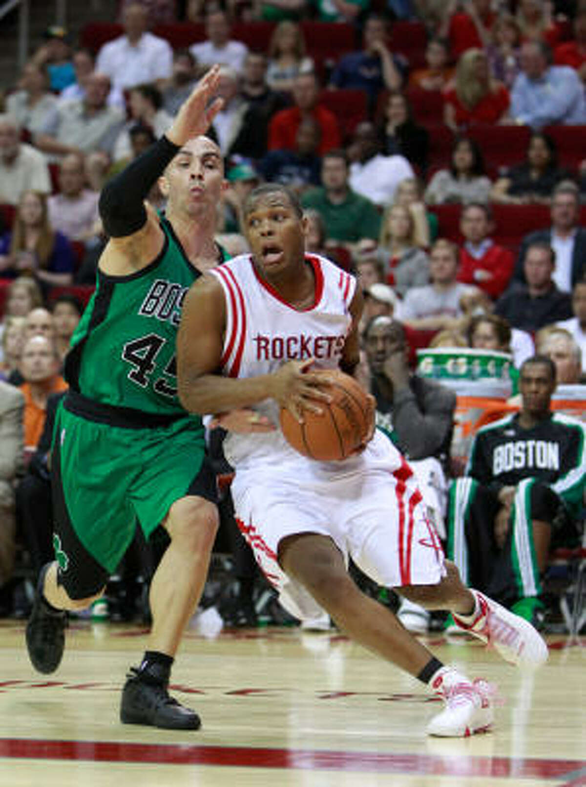 Celtics guard Carlos Arroyo, left, tries to slow down Rockets guard Kyle Lowry in the second half.