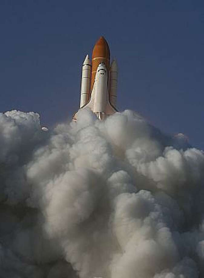 Space shuttle Discovery launches from pad 39A for the STS-133 International Space Station mission and Discovery's final mission at NASA's Kennedy Space Center Thursday, Feb. 24, 2011, in Kennedy Space Center. Photo: James Nielsen, Houston Chronicle