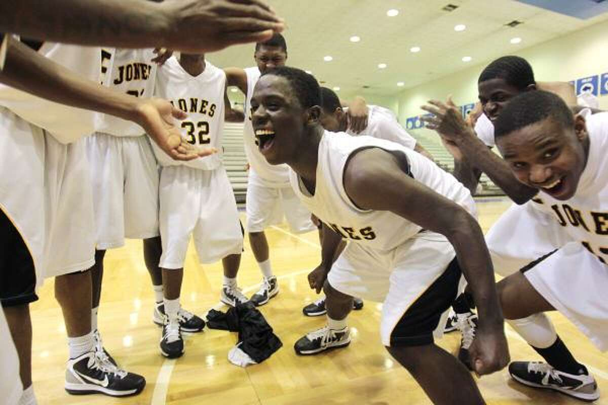 Jones High schools Jamarco Brown (1) leads his team in celebration after defeating Wheatley High school 95-74 in their match-up Wednesday February 16, 2011 at Barnett Fieldhouse in Houston, Texas.