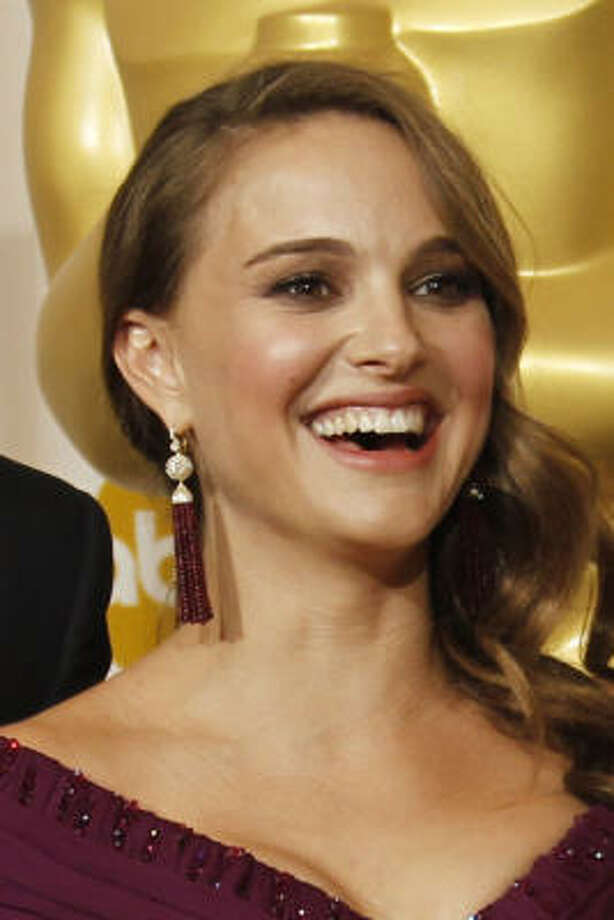 Natalie Portman drew criticism from Mike Huckabee because she's pregnant but not married. Photo: Matt Sayles, AP