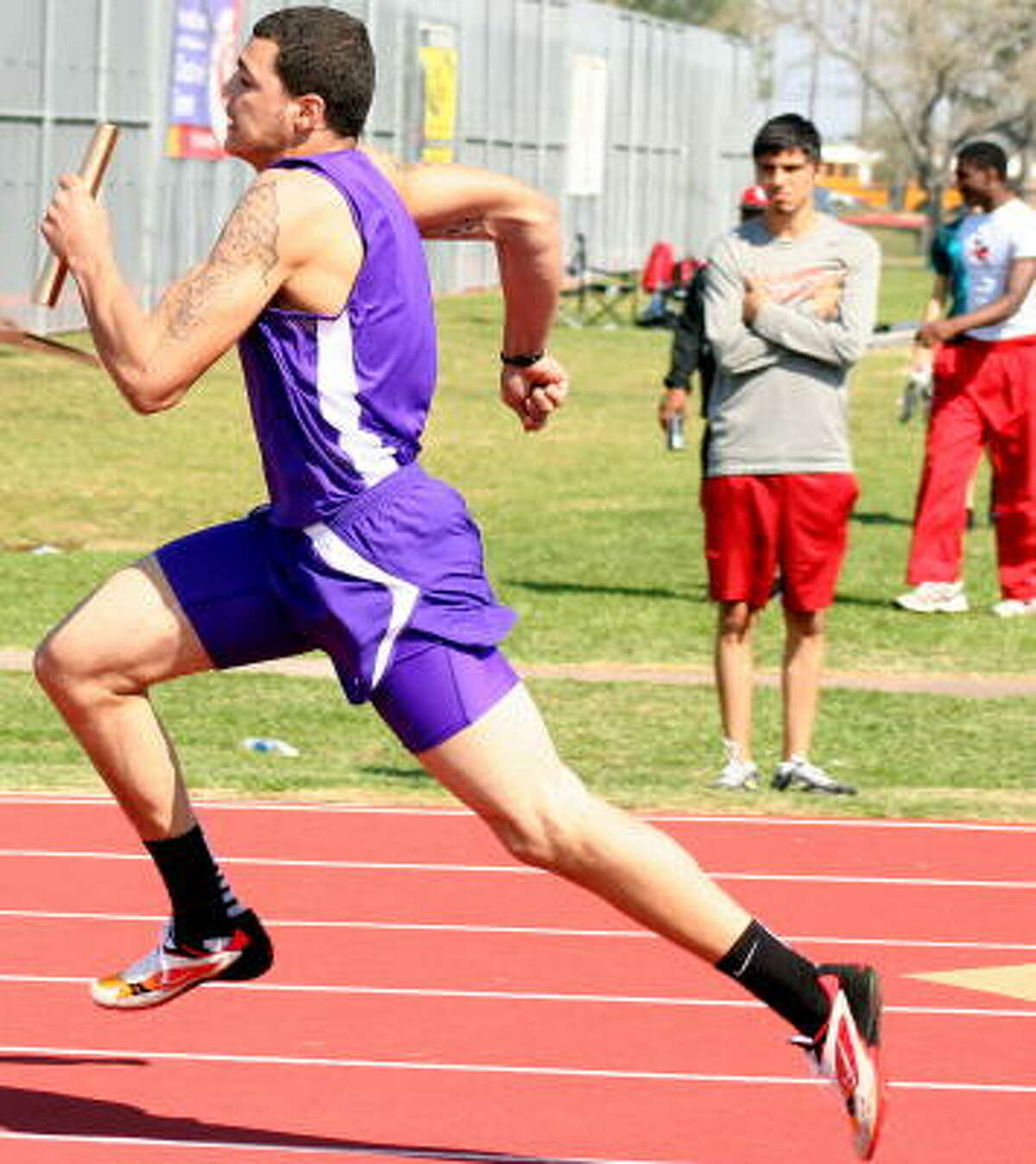 Ball'sMichael Evans jumped off the basketball court and onto the track for his school in the 400-meter relay.