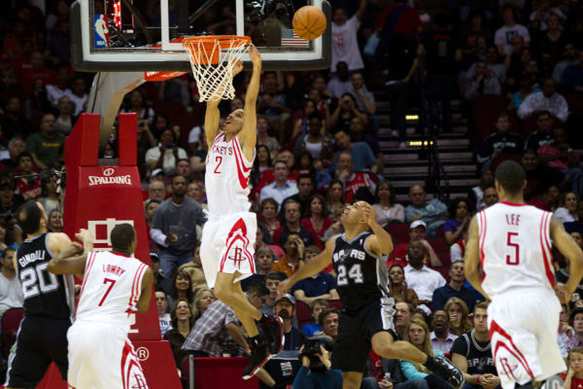 Rockets shooting guard Kevin Martin (12) comes up emptry as he tries to dunk the ball past Spurs small forward Richard Jefferson (24).
