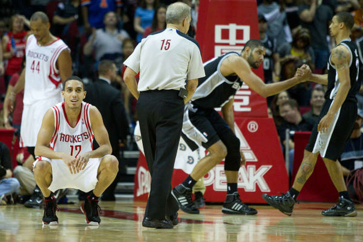 Rockets shooting guard Kevin Martin (12) reacts after a fouls against Spurs center Tim Duncan (21) during the final minutes of the fourth quarter.