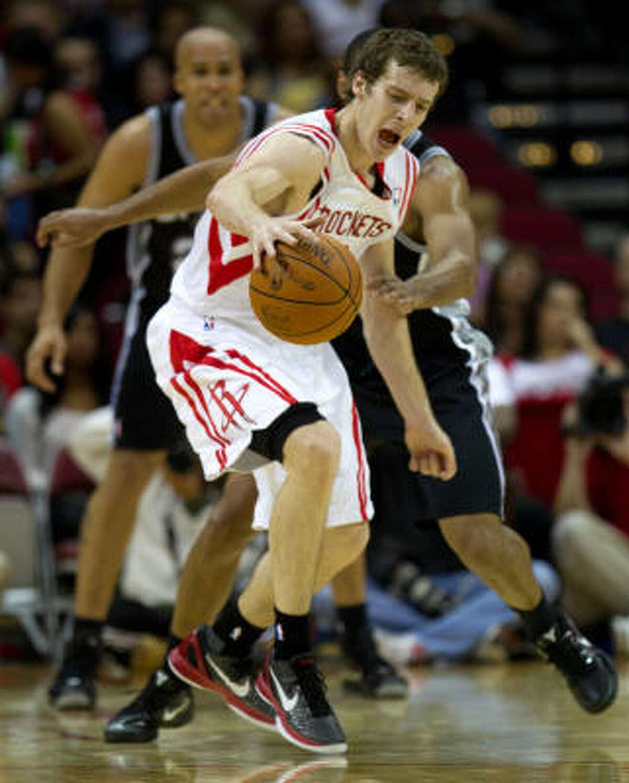 Rockets point guard Goran Dragic (3) tries to drive around Spurs point guard Gary Neal (14).