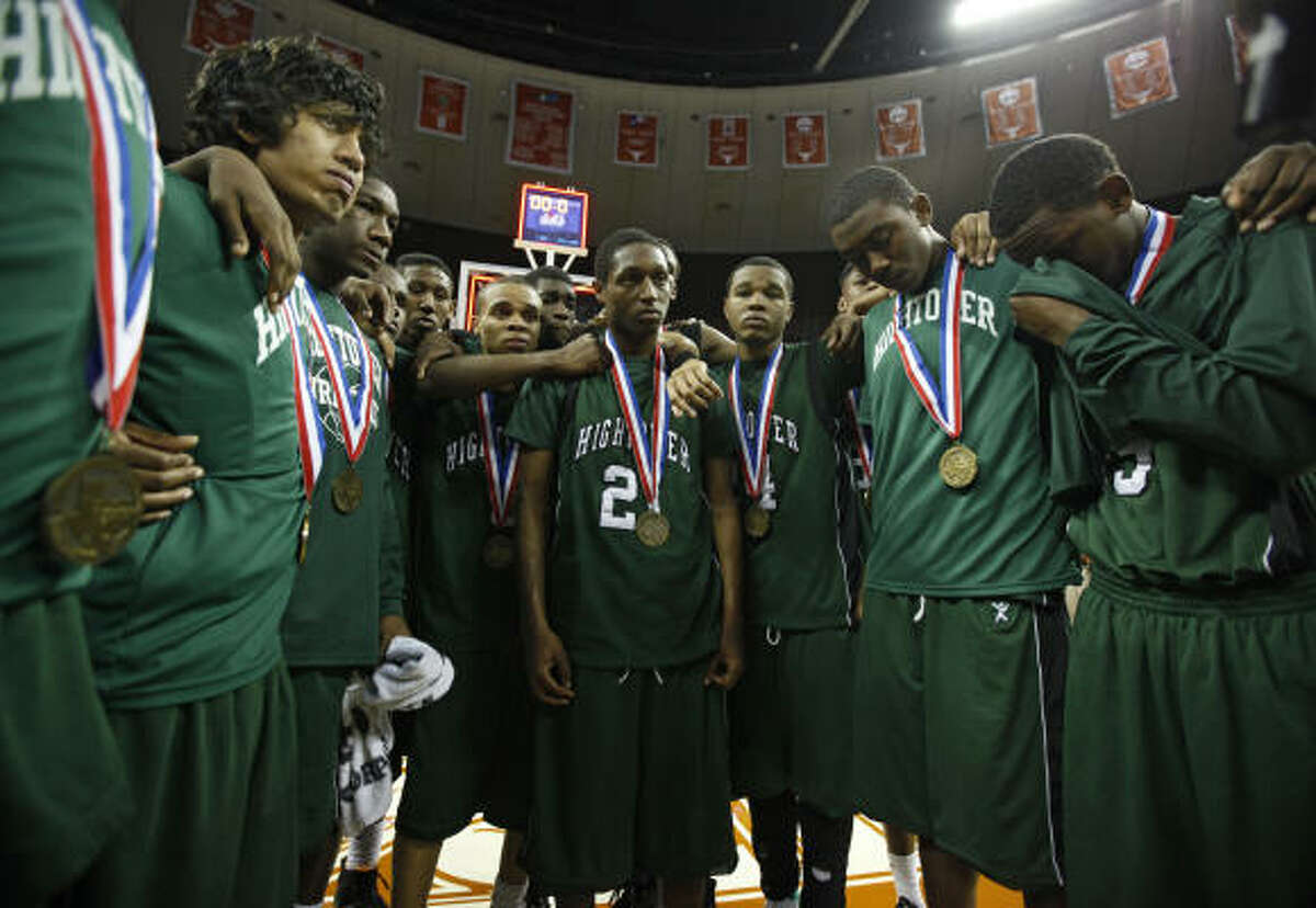 Hightower players gather after the medal ceremony after losing to Flower Mound Marcus.