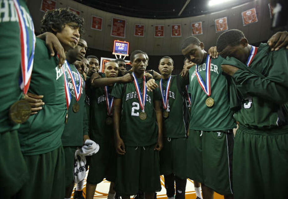 Hightower players gather after the medal ceremony after losing to Flower Mound Marcus. Photo: Erich Schlegel, Chronicle