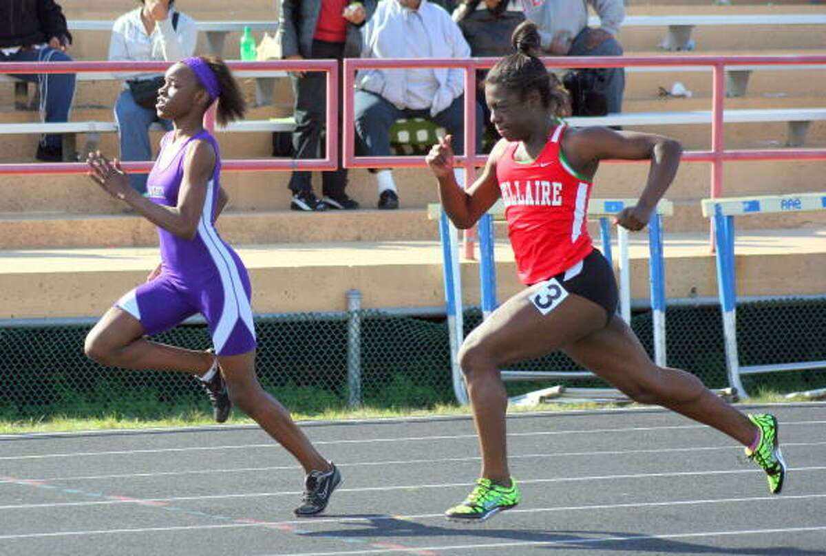 Wheatley's Daye Shon Roberson held off Bellaire's Courtney Meekins in the 100-meter dash.