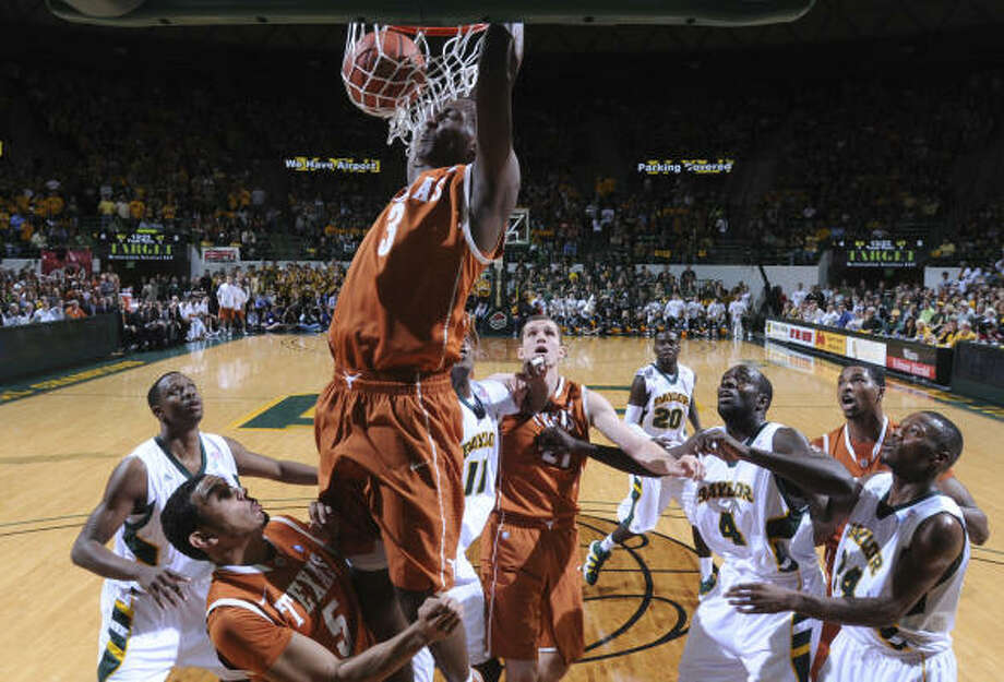 March 5: No. 7 Texas 60, Baylor 54 Texas' Jordan Hamilton slams home a dunk in the first half of Saturday's game in Waco. Photo: Tony Gutierrez, AP