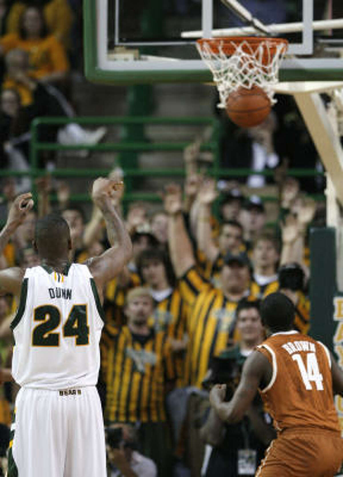 Baylor guard LaceDarius Dunn (24) makes a free throw as Texas' J'Covan Brown looks on in the first half. With the free throw, Dunn became the career scoring leader in Big 12 history, snapping Andre Emmett's mark of 2,256.