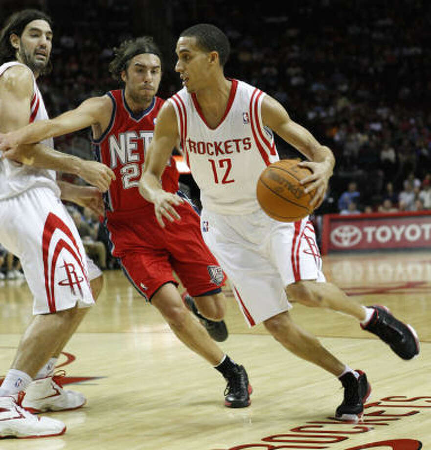 Feb. 26: Rockets 123, Nets 108 Rockets guard Kevin Martin, right, drives past New Jersey's Sasha Vujacic during the first quarter of Saturday night's game at Toyota Center. Martin finished with a game-high 30 points. Photo: Melissa Phillip, Chronicle