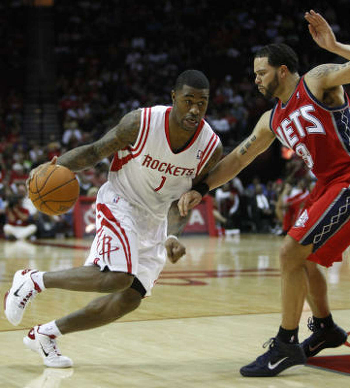 Rockets forward Terrence Williams tries to drive past New Jersey guard Deron Williams during the fourth quarter.