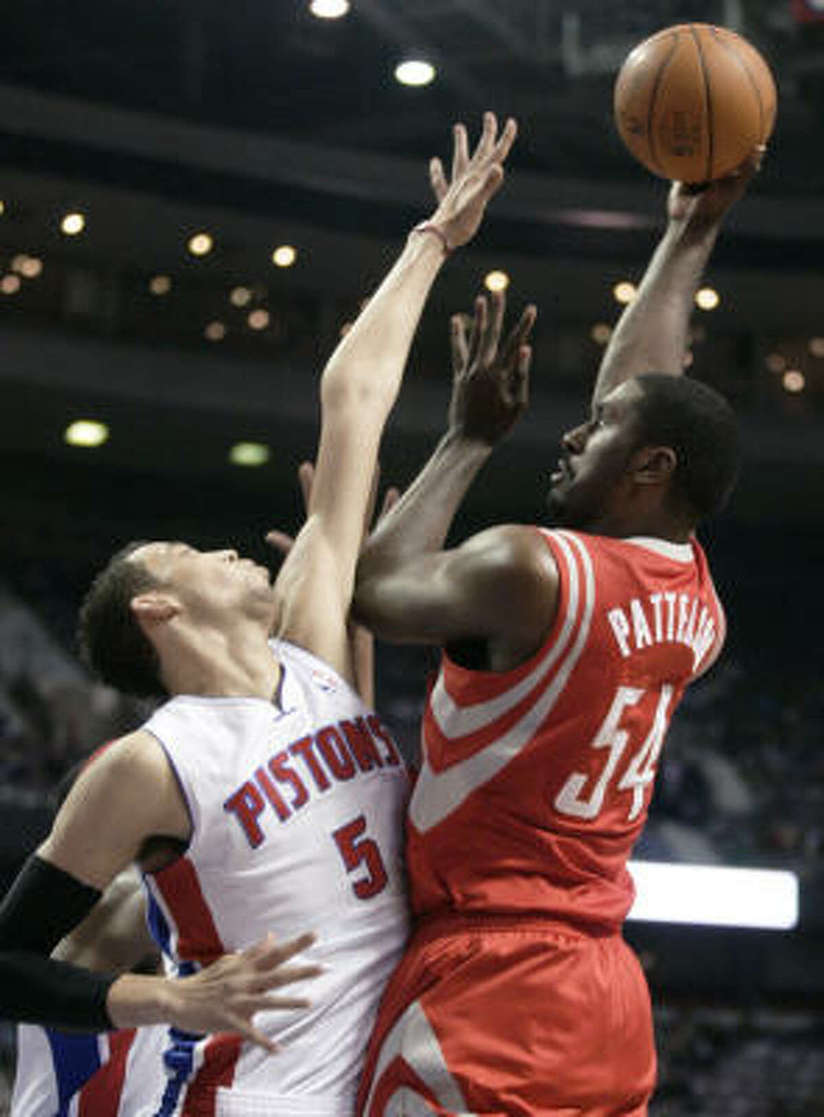 Rockets forward Patrick Patterson puts up a jumphook against Pistons forward Austin Daye during the first half.