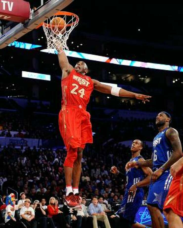 Lakers guard Kobe Bryant soars to the hoop for two of his game-high 37 points. Photo: Kevork Djansezian, Getty Images
