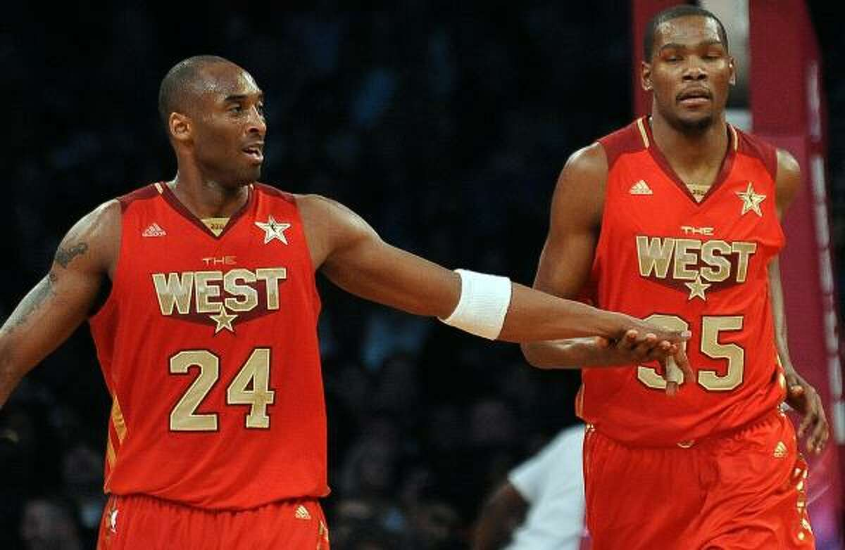 Los Angeles Lakers guard Kobe Bryant, left, was name the All-Star game's MVP after leading the Western Conference to a 148-143 victory Sunday night at Staples Center. Bryant led all scorers with 37 points and added 14 rebounds to claim his fourth All-Star game MVP award.