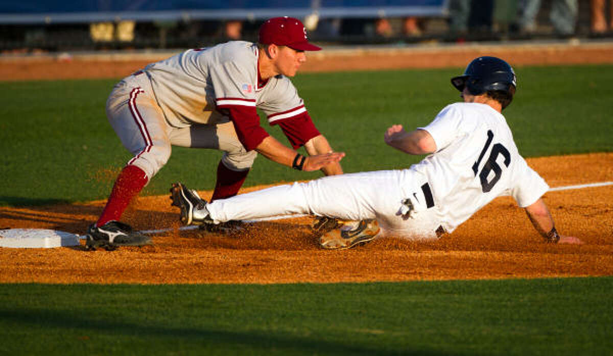 Stanford infielder Stephen Piscotty, left, tags out Rice's Ryan Lewis at third base.