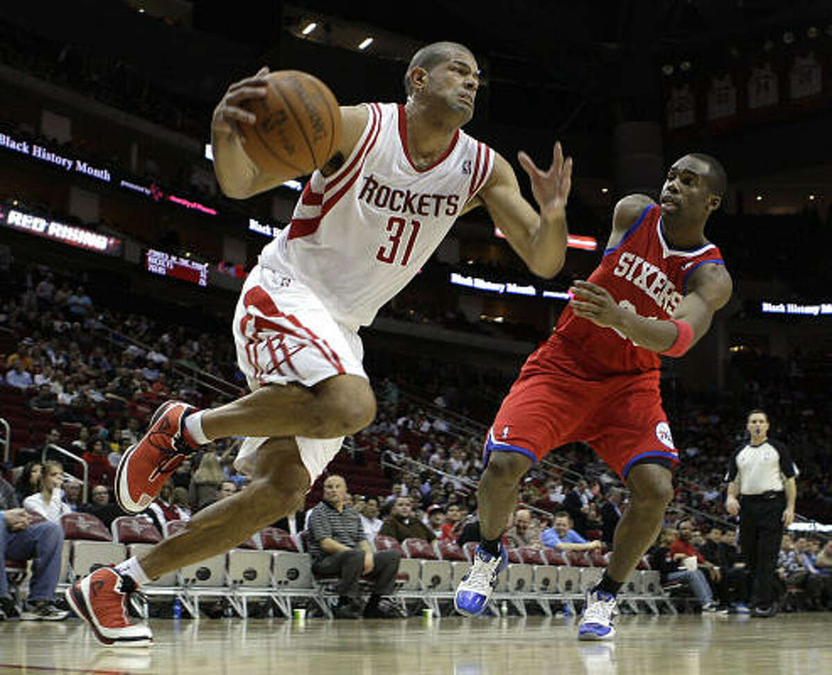 Rockets forward Shane Battier, left, breaks away from Philadelphia's Jodie Meeks on a drive to the basket during the third quarter.