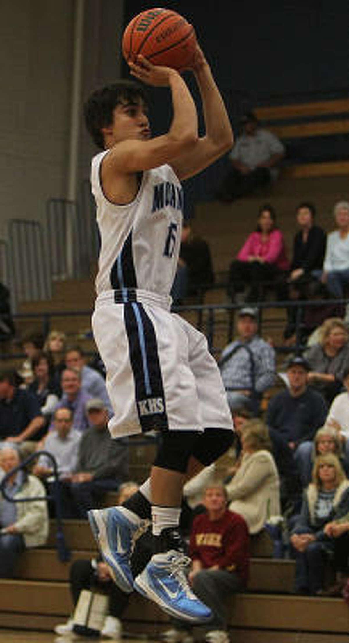 Kingwood's Kevin Acosta shoots the ball against Oak Ridge.