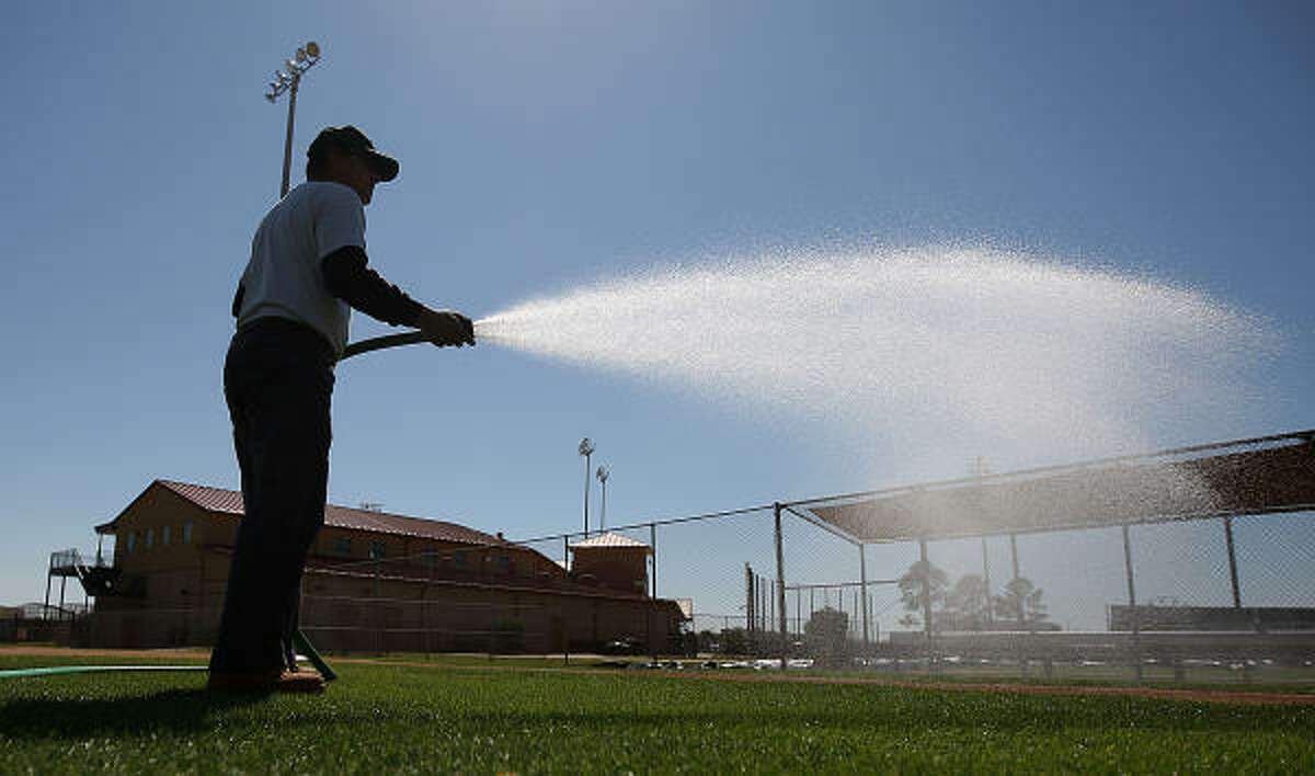 Osceola County Stadium ground crew member Eric Perez waters one of the fields at the Houston Astros Spring Training facility.