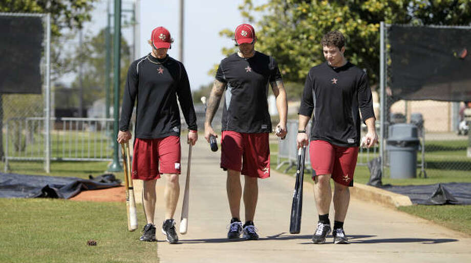 Catcher J.R. Towles, left, Brian Dopirak, center, and Brett Wallace, right, walk back to the clubhouse after hitting in the batting cages. Photo: Karen Warren, Chronicle