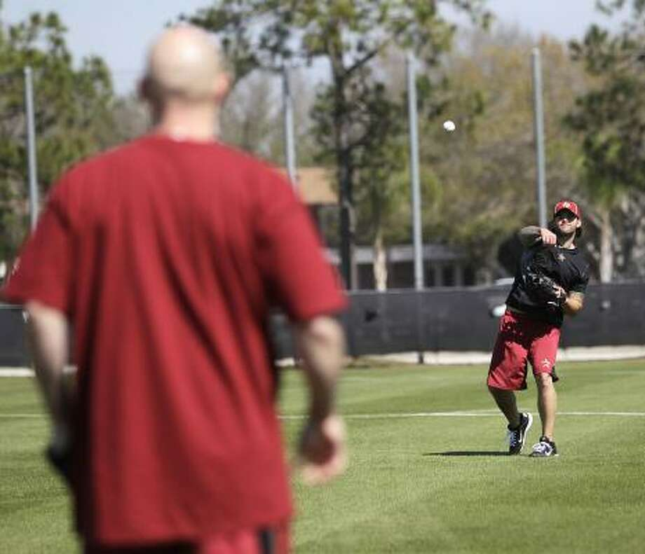 Brian Dopirak, in black, plays catch with Clint Barmes. Photo: Karen Warren, Chronicle