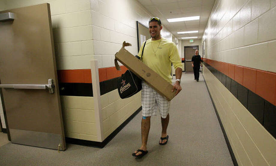 J.D. Martinez walks into the Astros clubhouse with his gear. Photo: Karen Warren, Chronicle