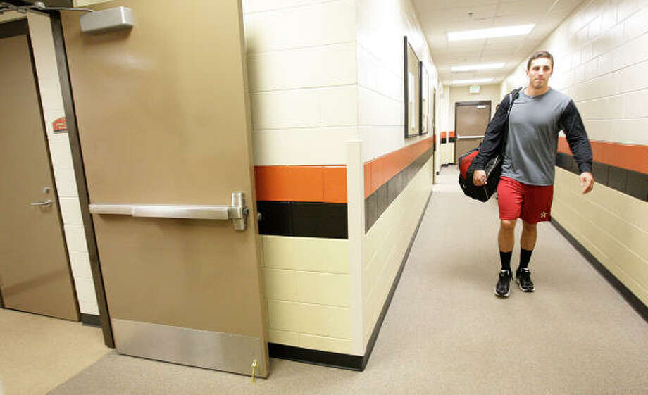 Jason Castro walks into the Astros clubhouse at their Spring Training facility. Photo: Karen Warren, Chronicle