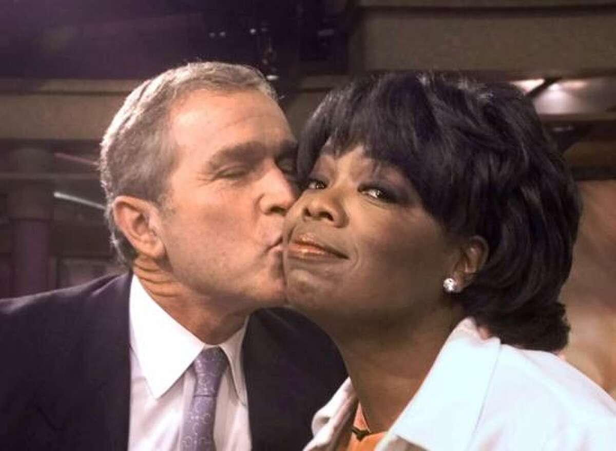 Some kisses are just kinda funny. Such as the kiss captured when Gov. George W. Bush greeted talk show host Oprah Winfrey.