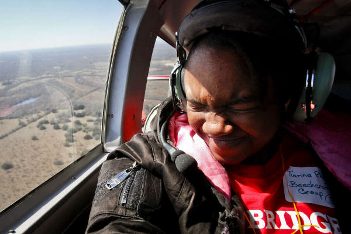 Tianna Rhodes, 11, reacts to what is her first flight ever.