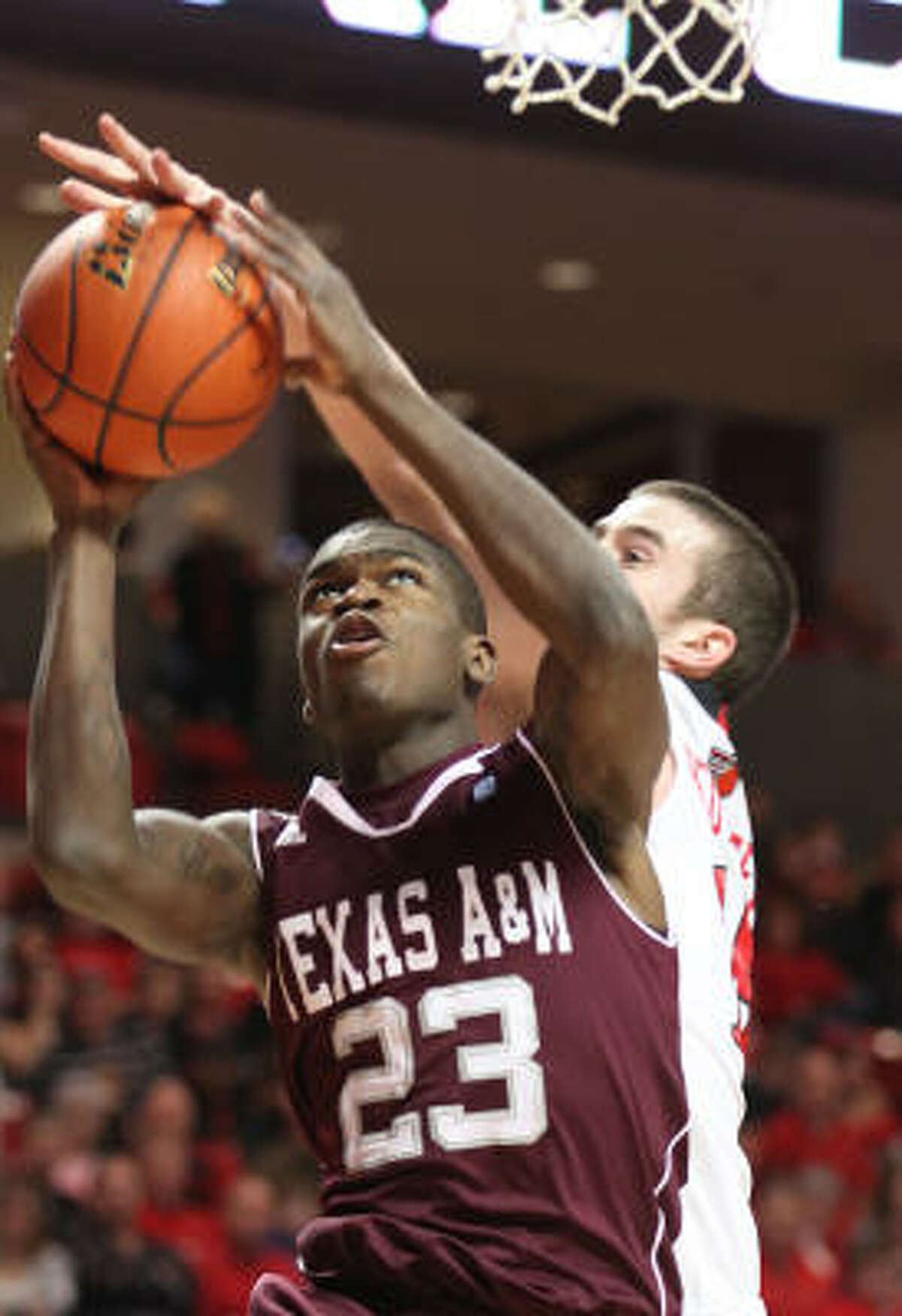 Texas A&M's Naji Hibbert has his shot blocked by Texas Tech's Robert Lewandowski.