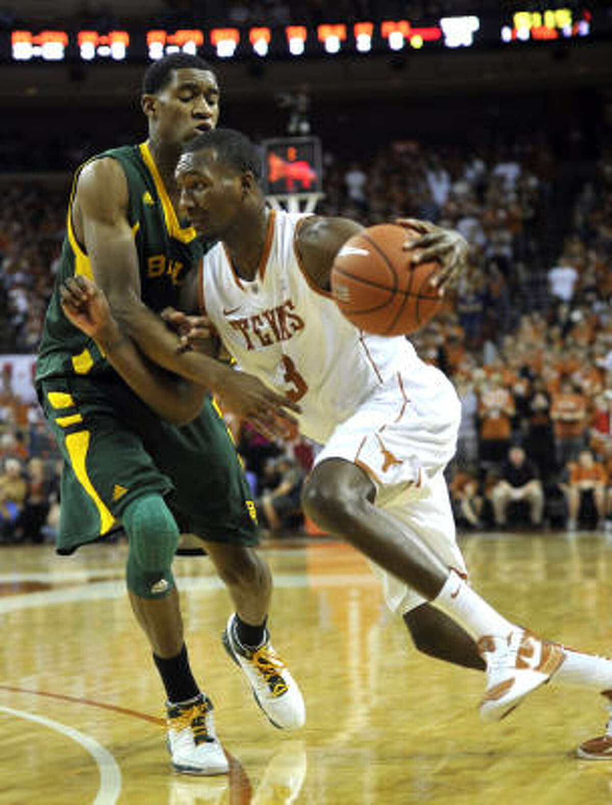 Texas forward Jordan Hamilton (3) drives around Baylor forward Perry Jones III during the first half. Hamilton scored 17 points.