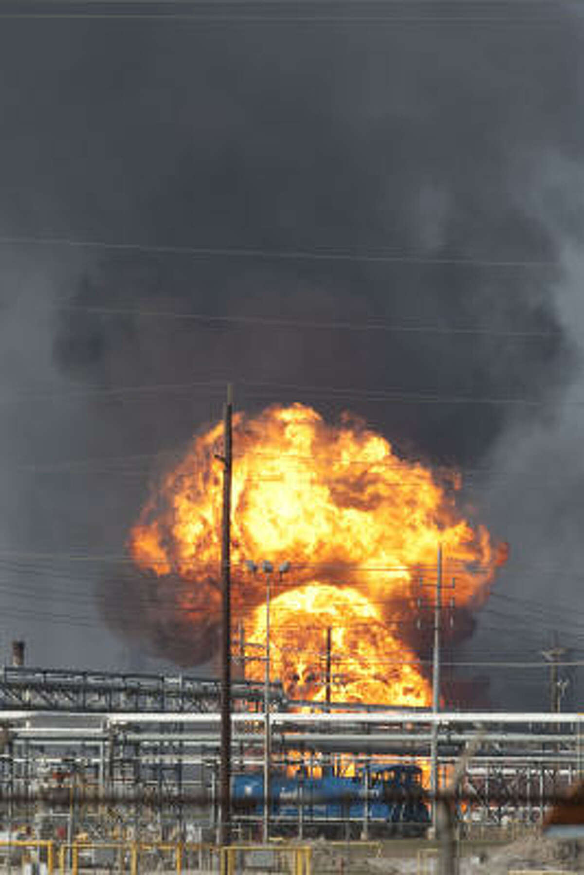 Flames and smoke rise from an explosion at Enterprise Products Partners' natural gas processing complex on Sun Oil Road in Mont Belvieu, Texas.