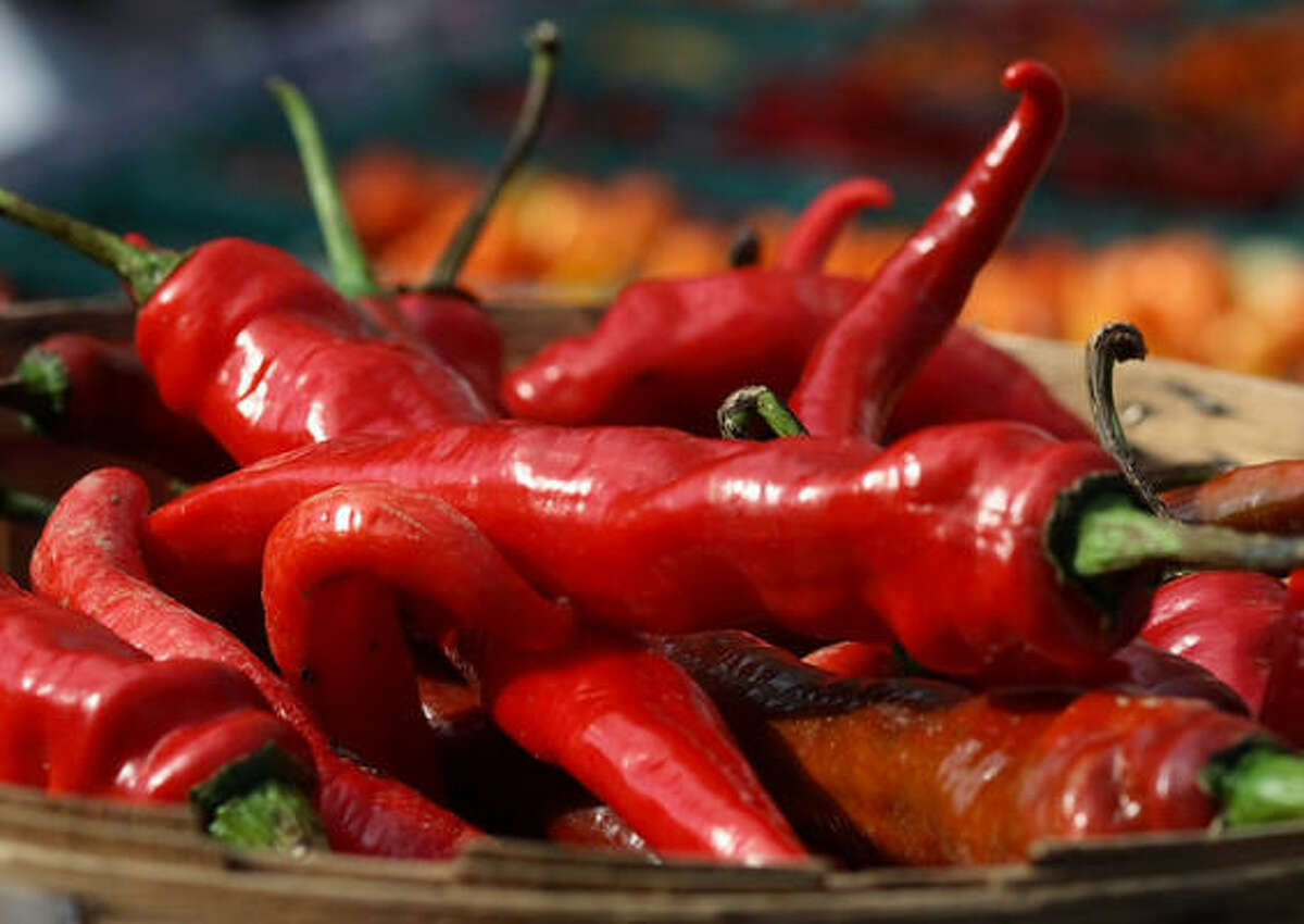 Chili peppers Spicy foods, especially chilis, make you sweat, flush and increase your heart rate.