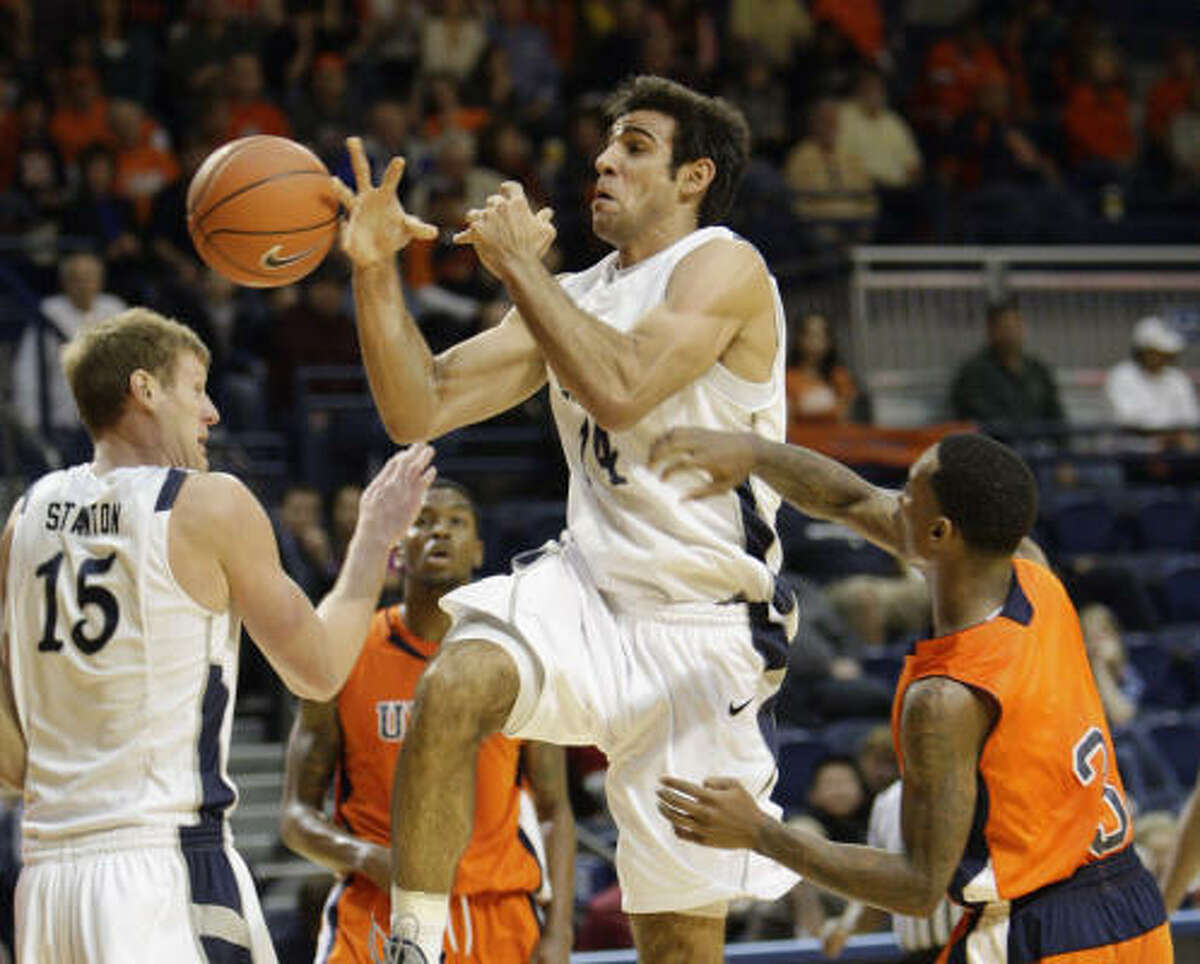 UTEP 59, Rice 53 Rice's Arsalan Kazemi (14) is fouled by UTEP's Randy Culpepper (3) as he drives to the basket.