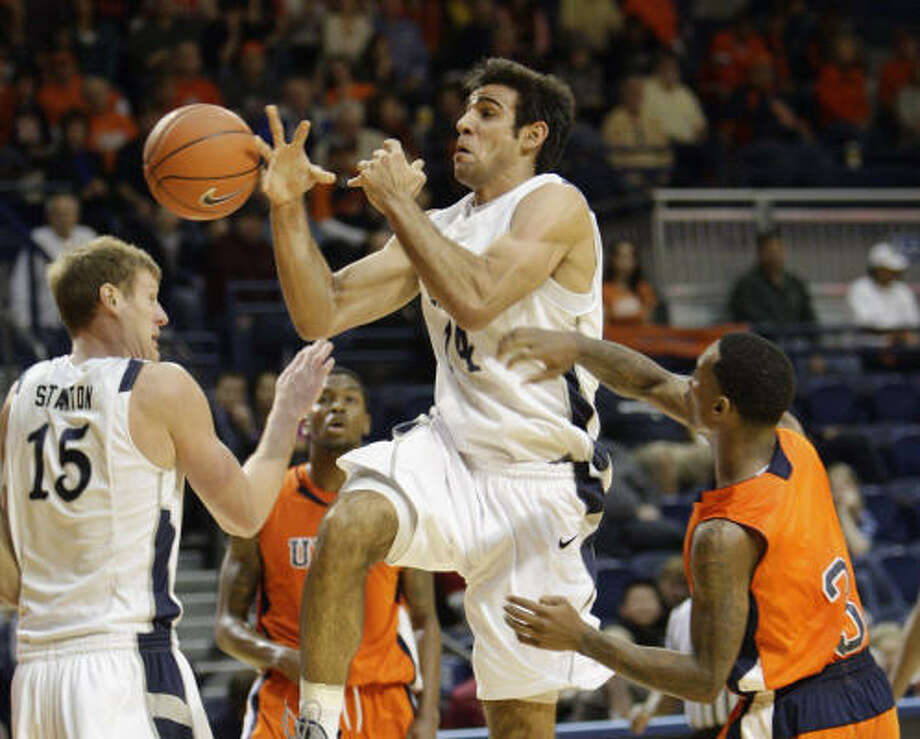 UTEP 59, Rice 53 Rice's Arsalan Kazemi (14) is fouled by UTEP's Randy Culpepper (3) as he drives to the basket. Photo: Bob Levey, AP