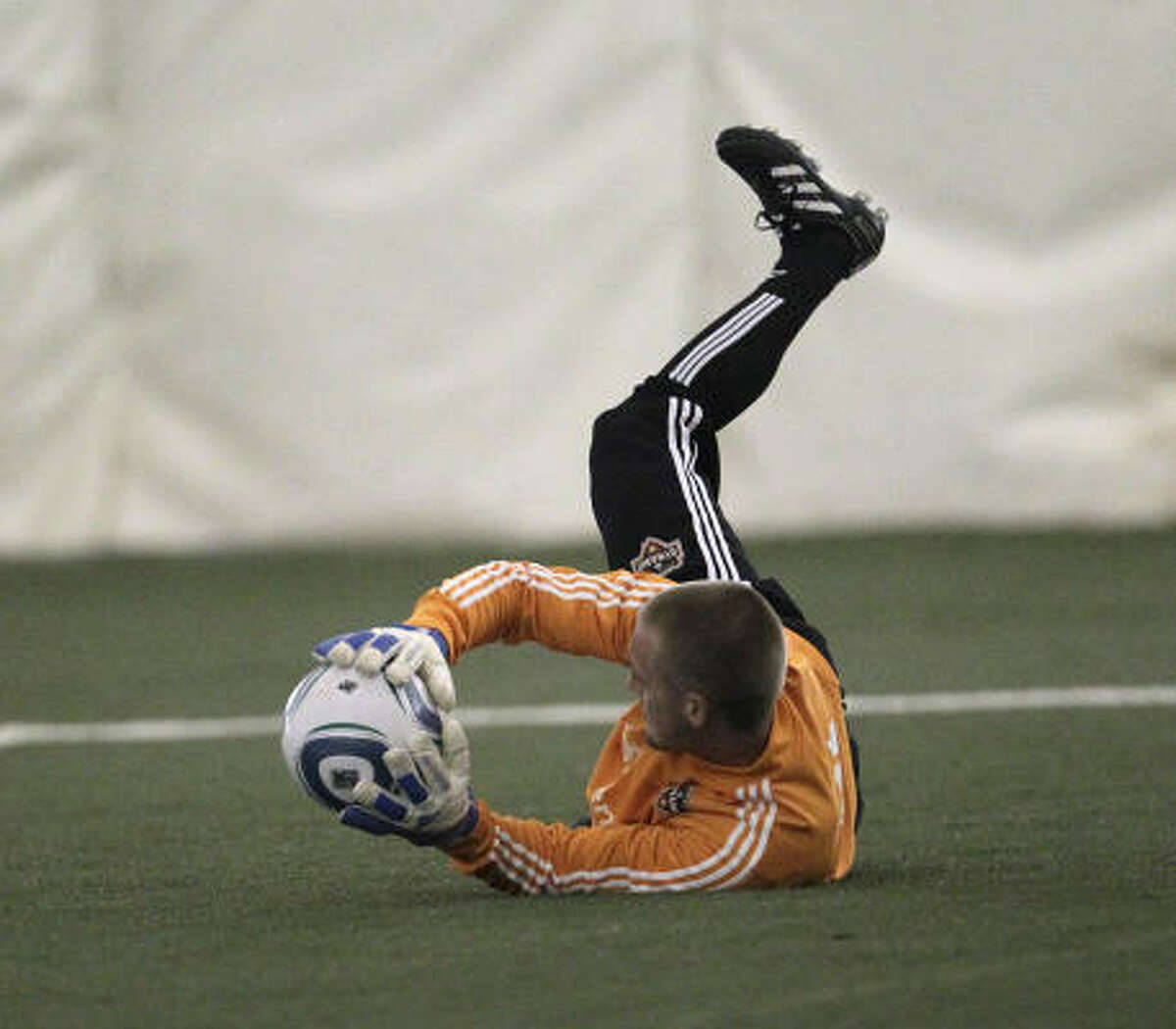 Dynamo goalkeeper Evan Newton completes a practice drill.