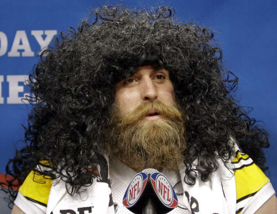Pittsburgh Steelers' defensive lineman Brett Keisel has a little fun with a Troy Polamalu wig during his media day session  Tuesday. Photo: Eric Gay, AP
