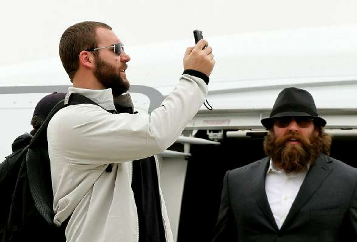 Quarterback Ben Roethlisberger and defensive lineman Brett Keisel arrive at Dallas/Fort Worth International Airport on Jan. 31 in Dallas. The Pittsburgh Steelers will play the Green Bay Packers in Super Bowl XLV on Feb. 6, 2011 at Cowboys Stadium.