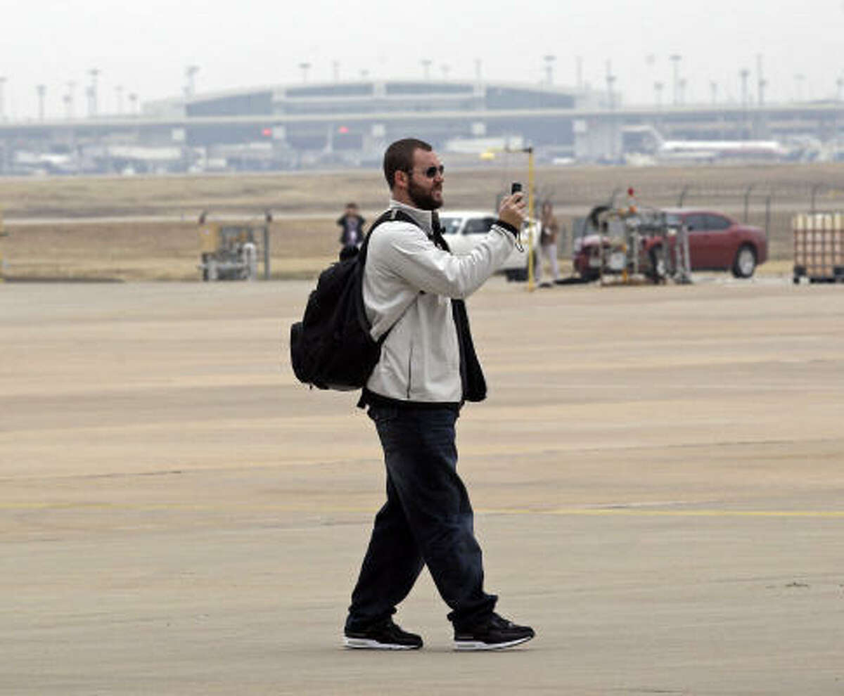 Steelers' Ben Roethlisberger shoots video after arriving at Dallas/Fort Worth International Airport for NFL football Super Bowl XLV Monday.