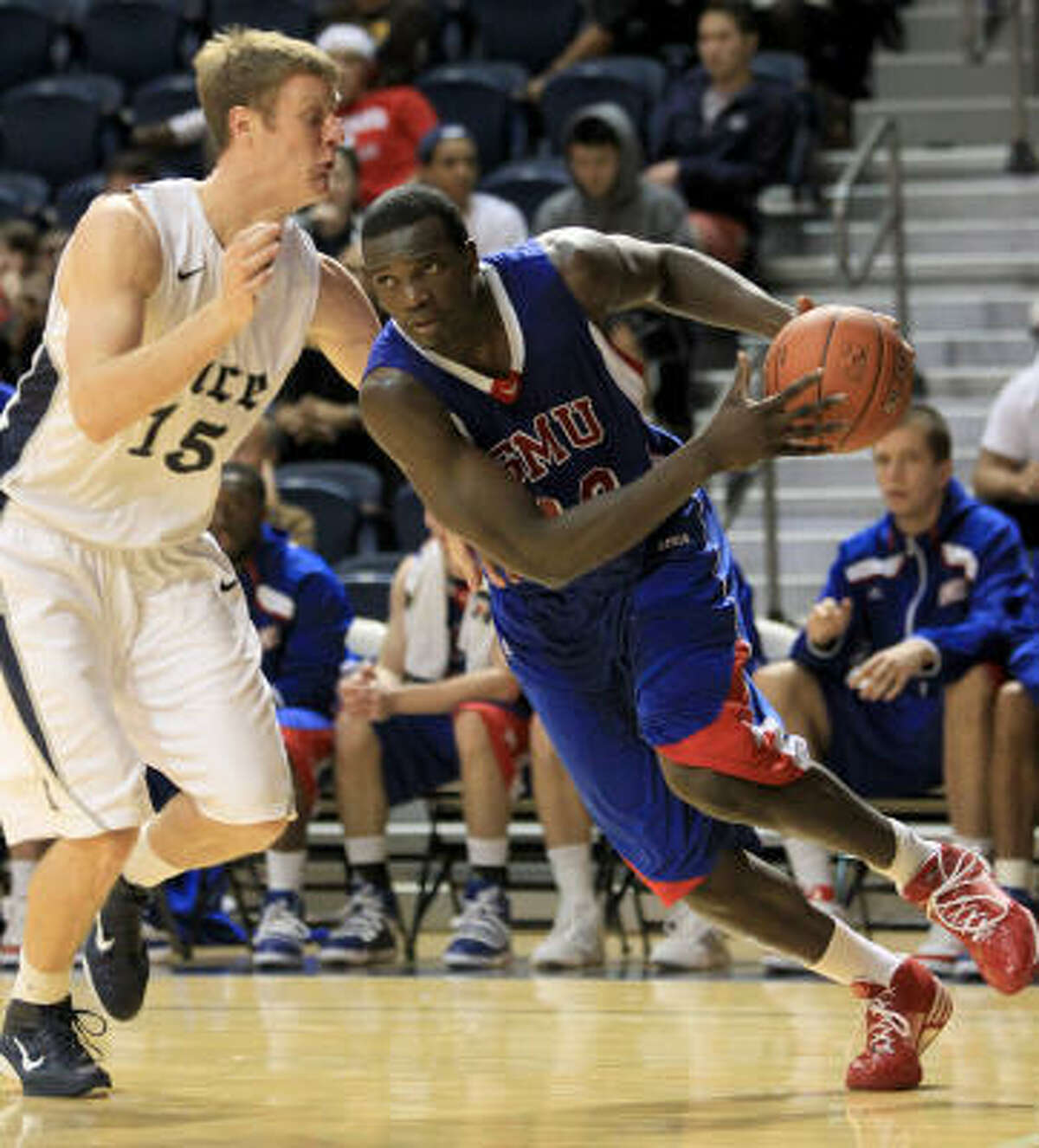 SMU forward Papa Dia drives around Owls center Trey Stanton (15) during the second half. Dia finished with 19 points and three blocks.