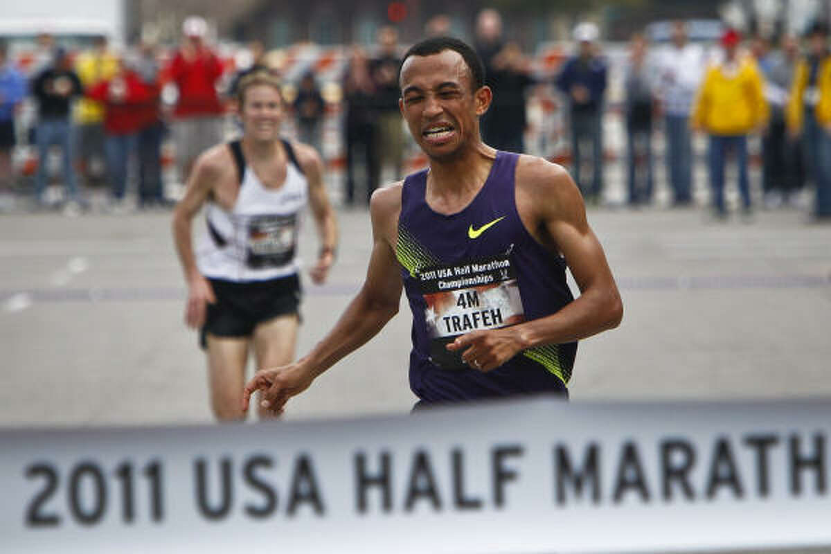 Mo Trafeh sprints to the finish line for first place ahead of Ryan Hall during the 2011 U.S. Half Marathon Championships on Saturday.