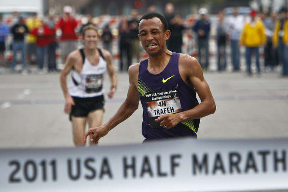 Mo Trafeh sprints to the finish line for first place ahead of Ryan Hall during the 2011 U.S. Half Marathon Championships on Saturday. Photo: Michael Paulsen, Chronicle