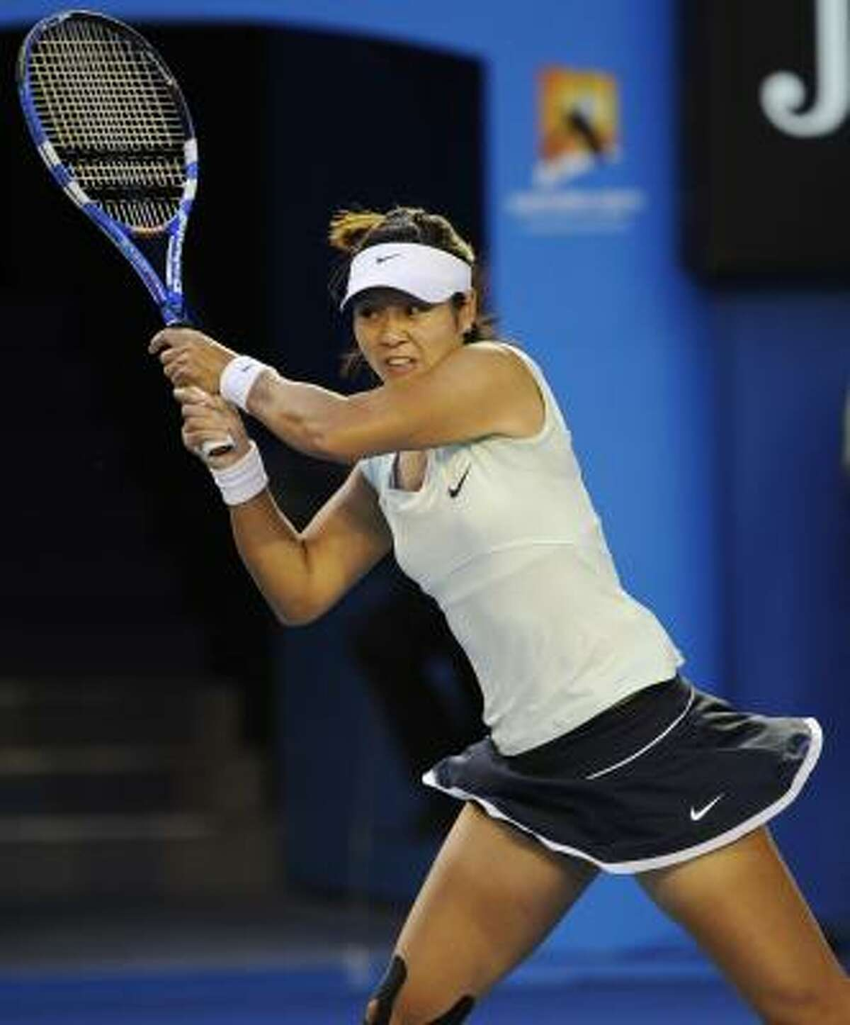 Li Na makes a backhand return to Kim Clijsters during Saturday's championship match. Li was the first Chinese player to reach a Grand Slam singles final.