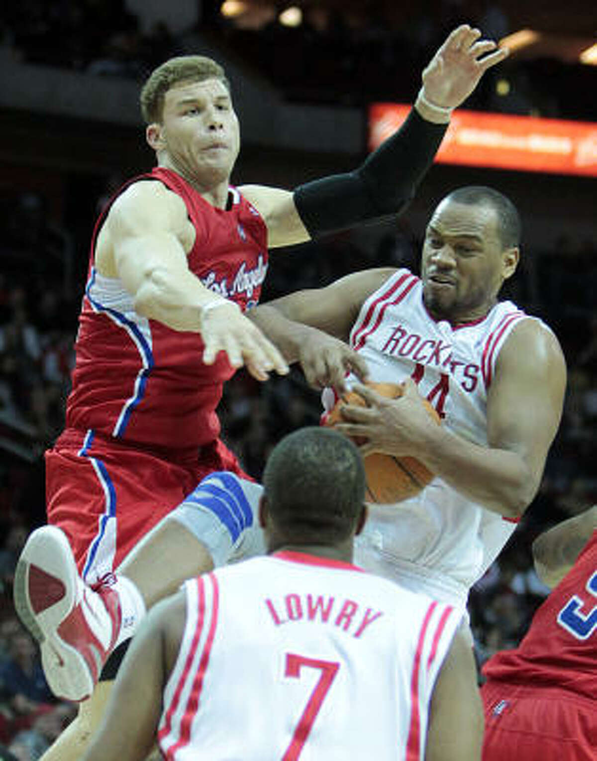 Rockets center Chuck Hayes (44) pulls down a rebound away from Clippers forward Blake Griffin (32).