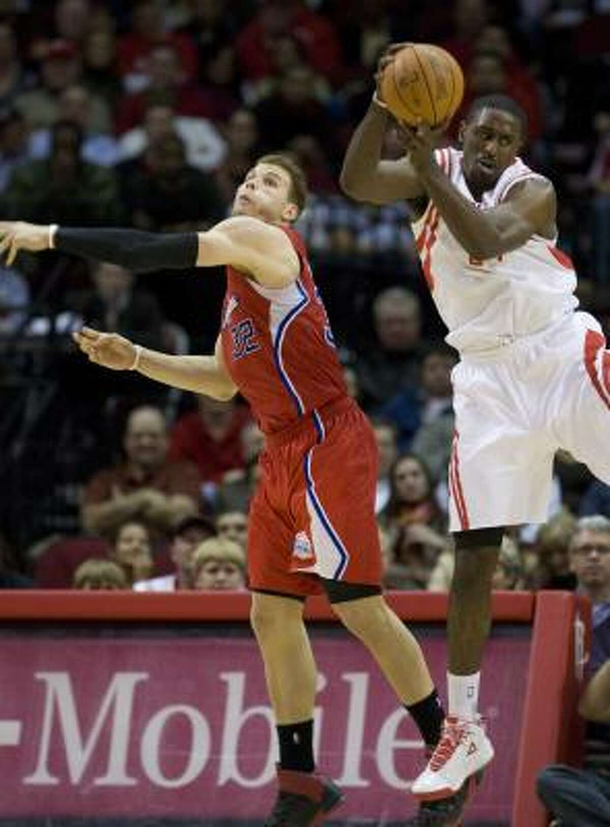 Clippers forward Blake Griffin (32) goes for a steal and misses as Rocekts forward Patrick Patterson (54) pulls in the ball.