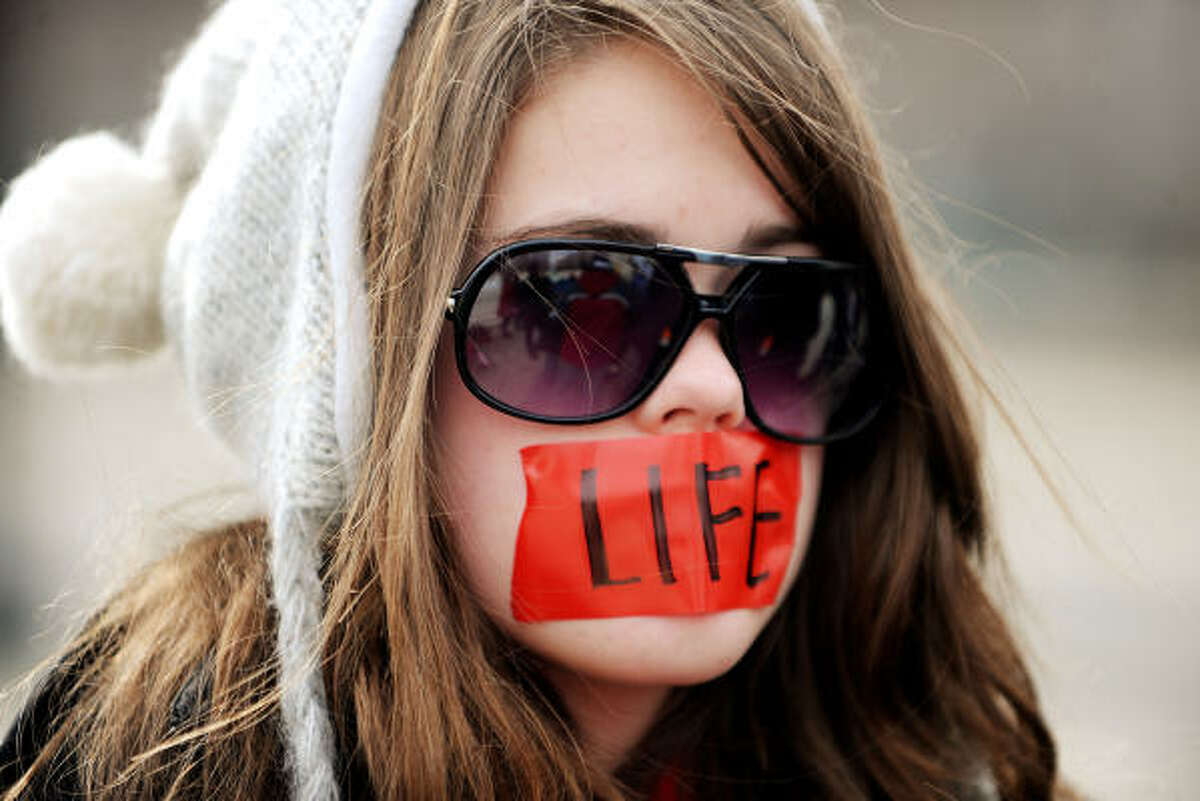 Prayer group Bound4LIFE tapes their mouths as a symbol of their