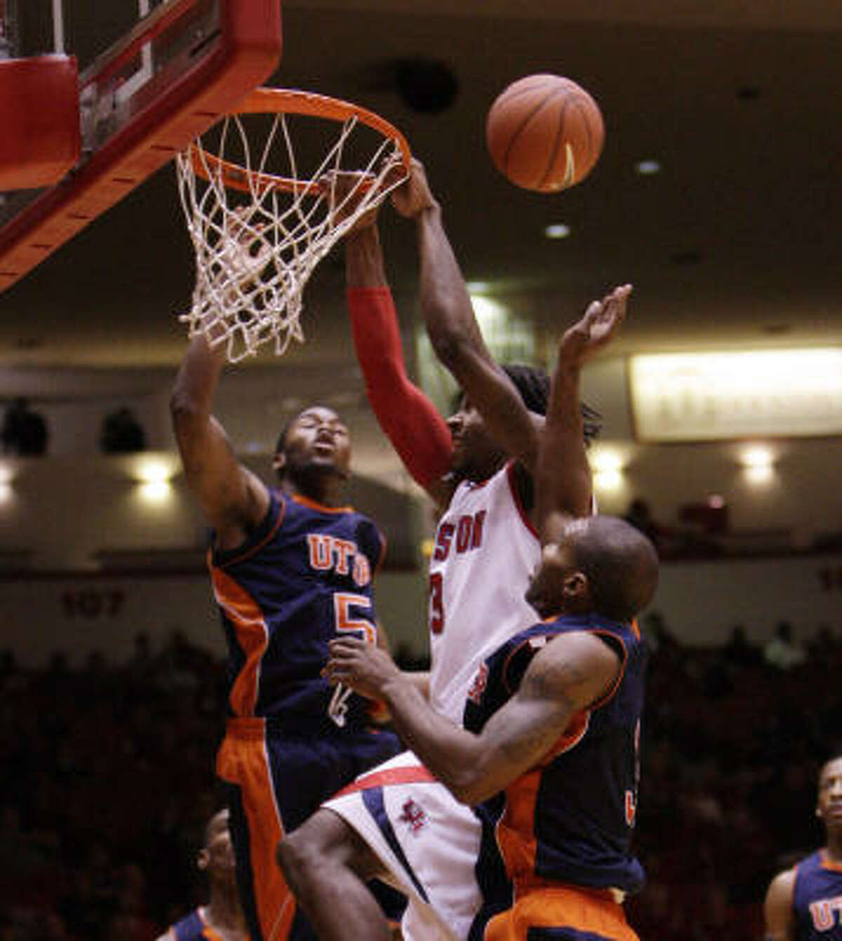 UH forward Maurice McNeil misses a follow-up dunk over UTEP's Julyan Stone (5) and Randy Culpepper during the first half.